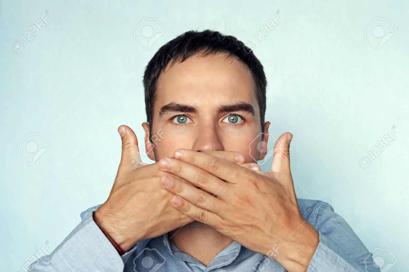 man covers her mouth. businessman closes his mouth. - 106918554