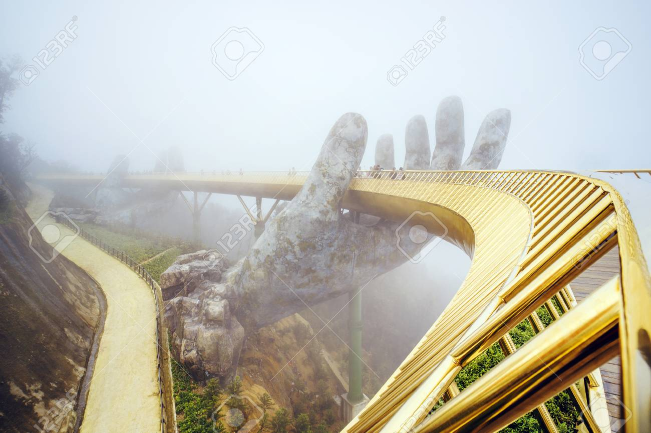 Danang , Vietnam. View in Fog of the Golden Bridge on Ba Na Hills in Da Nang on rainy day. - 121441980