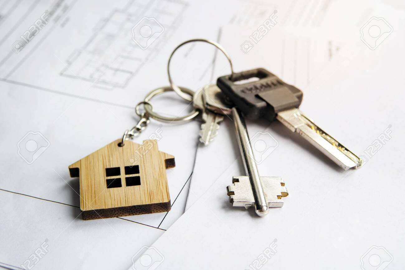 keychain in the form of a house. Model house, construction plan for house building, keys. Real Estate Concept. Top view. - 132173650