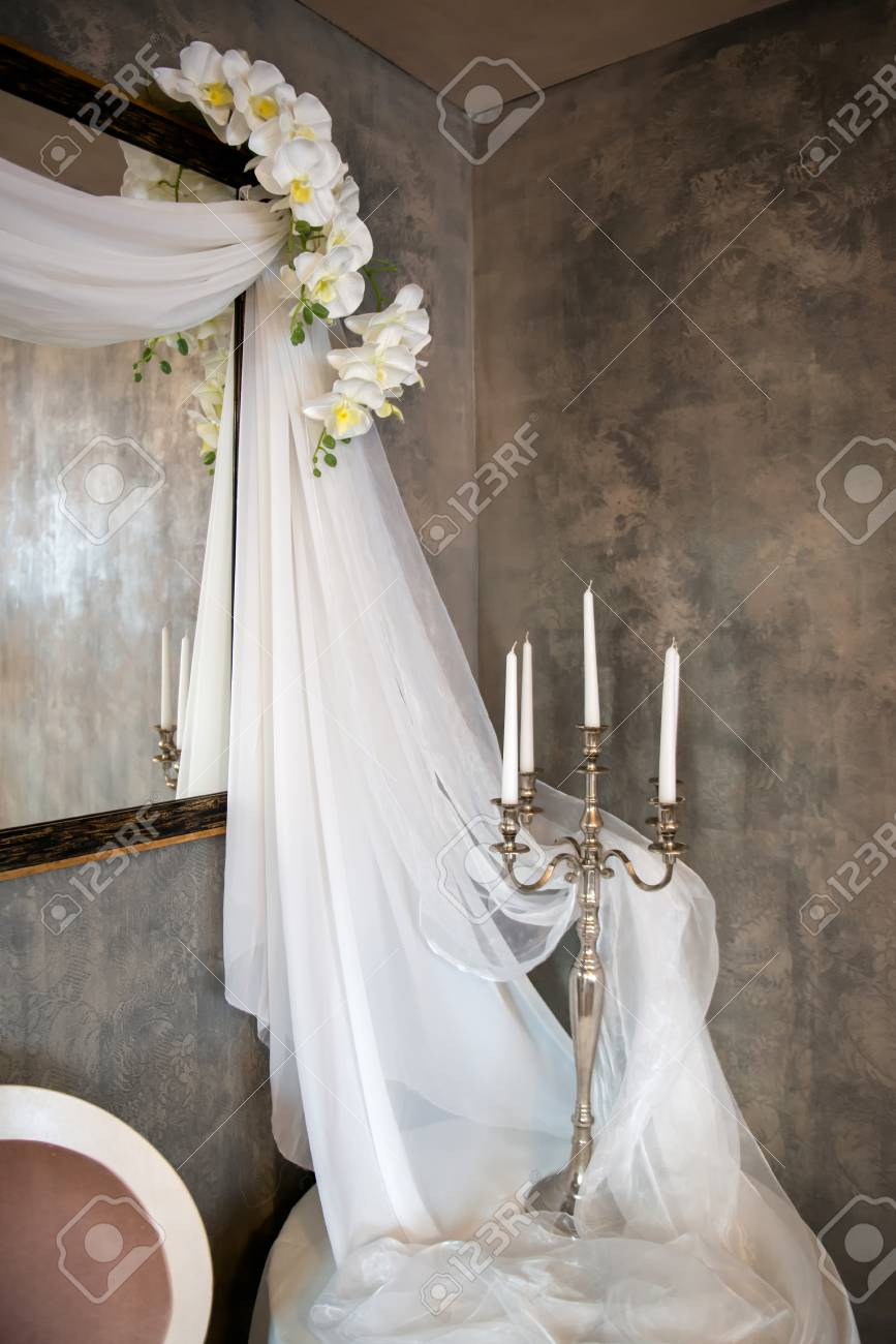 Wedding Vintage Decor With Veils Candles And Orchids Vertical