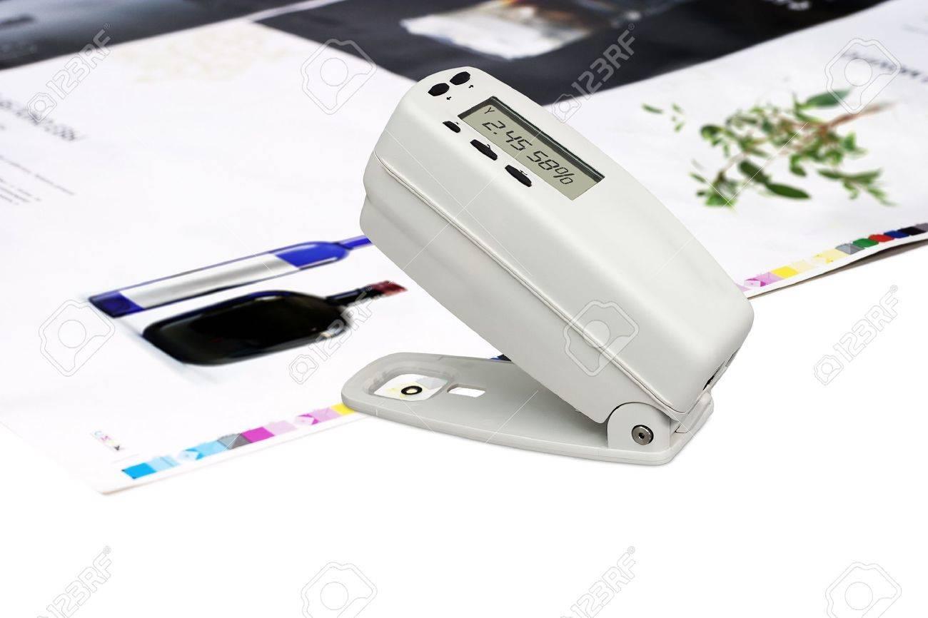 Measuring color density with densitometer on offset printed sheet - 10401067