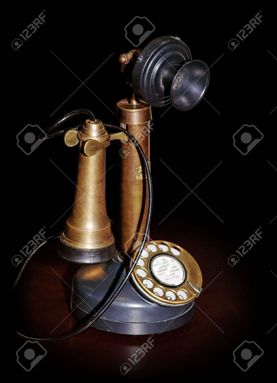 Vintage phone on table isolated on black (pure black edges on picture) with clipping path - 10160346