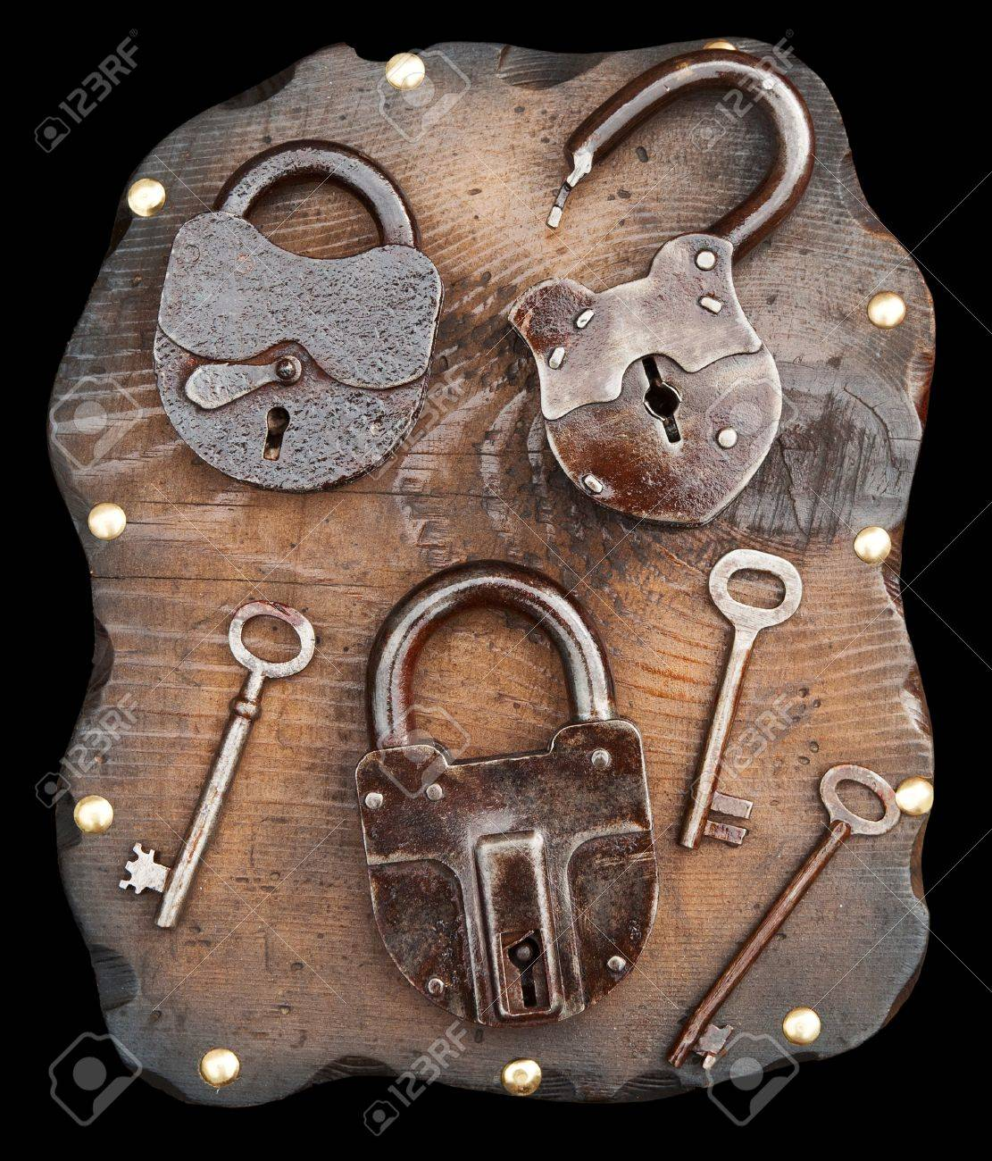 old locks and keys on wooden plank isolated stock photo picture and