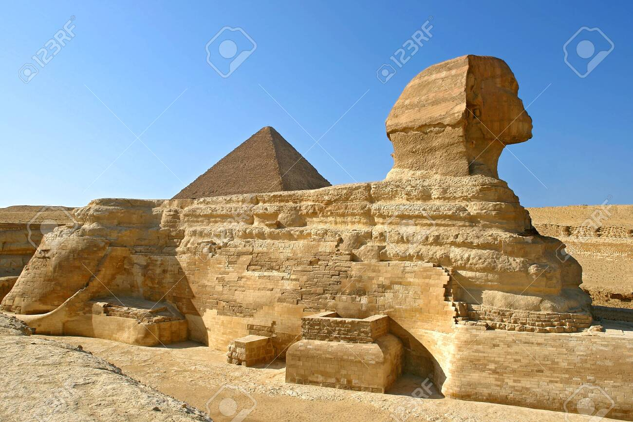 Great Sphinx of Giza profile with pyramid of Khafre in the background - Cairo, Egypt - 136074260