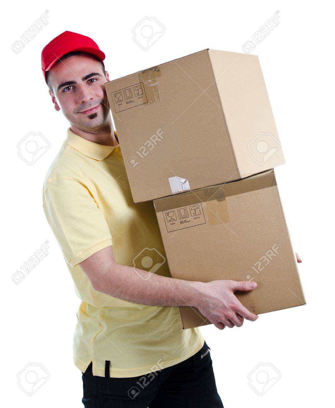 Young delivery man delivering two heavy parcels Stock Photo - 13215724