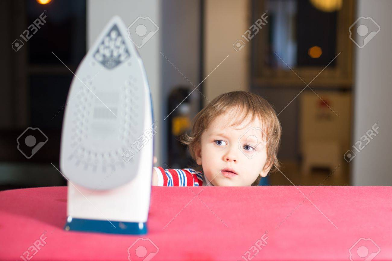 High Quality Little Baby Boy Is Reaching To Hot Iron   Danger At Home Stock Photo    17106827