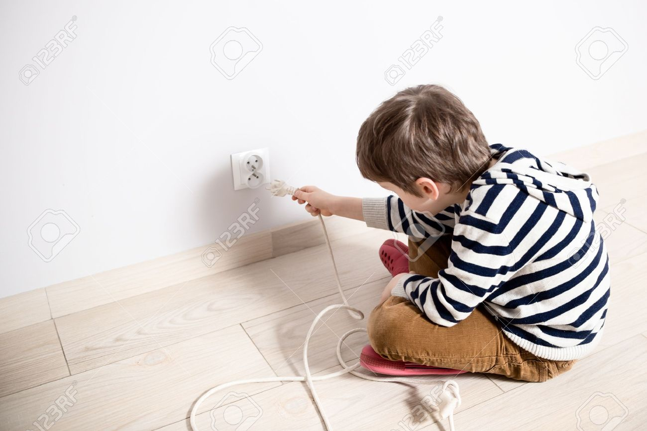 Exceptional Stock Photo   Curious Little Boy Playing With Electric Plug. Trying To  Insert It Into The Electric Socket. Danger At Home