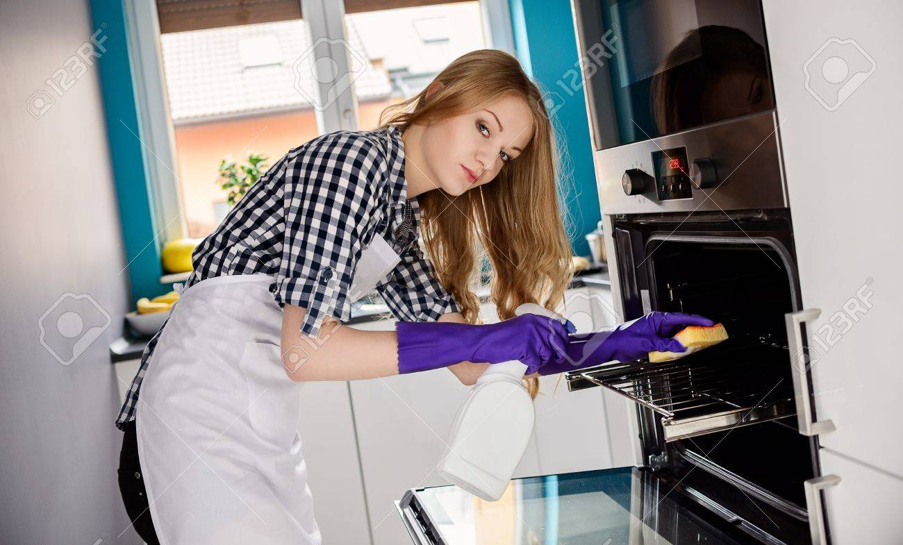White rubber apron - Rubber Gloves On Her Hands Using Cleaning Fluid