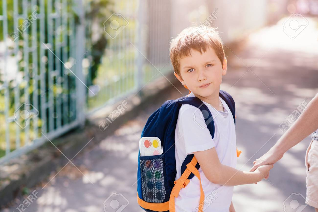 Little 7 years old boy going to school with his mother - 61929009
