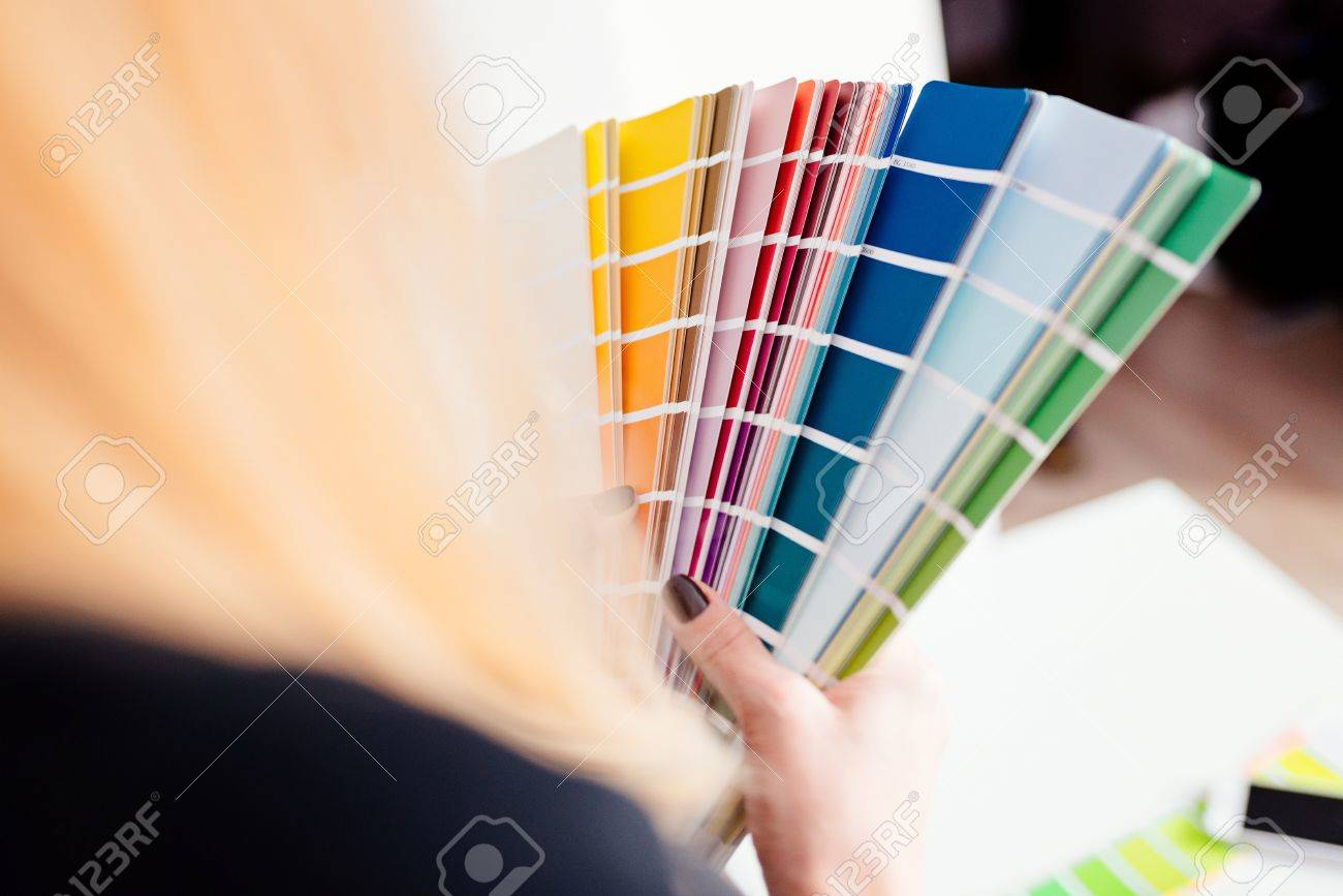 Stock Photo   Woman Designer Or Architect Choosing Color From Color Palette