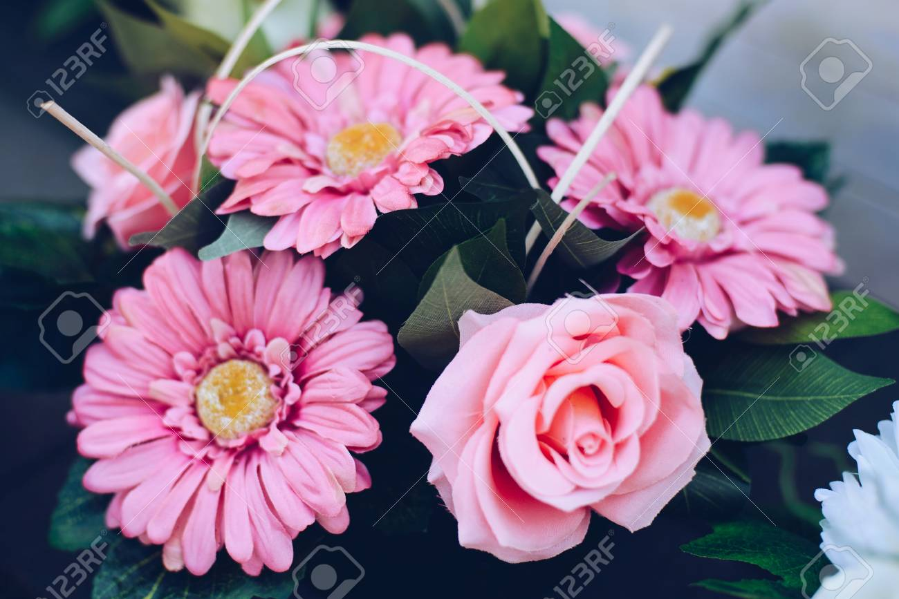 Flowers Arrangement With Pink Gerbera Daisies And Rose Stock Photo