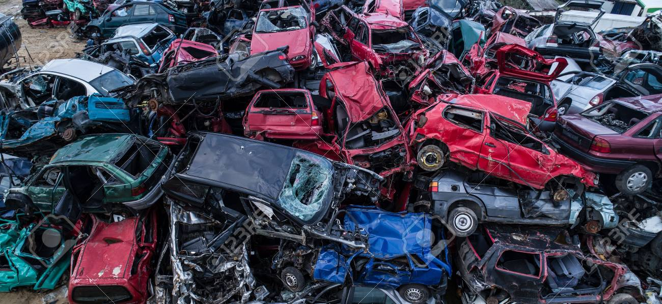 Old Rusty Corroded Cars In Car Scrapyard. Car Recycling Stock Photo ...