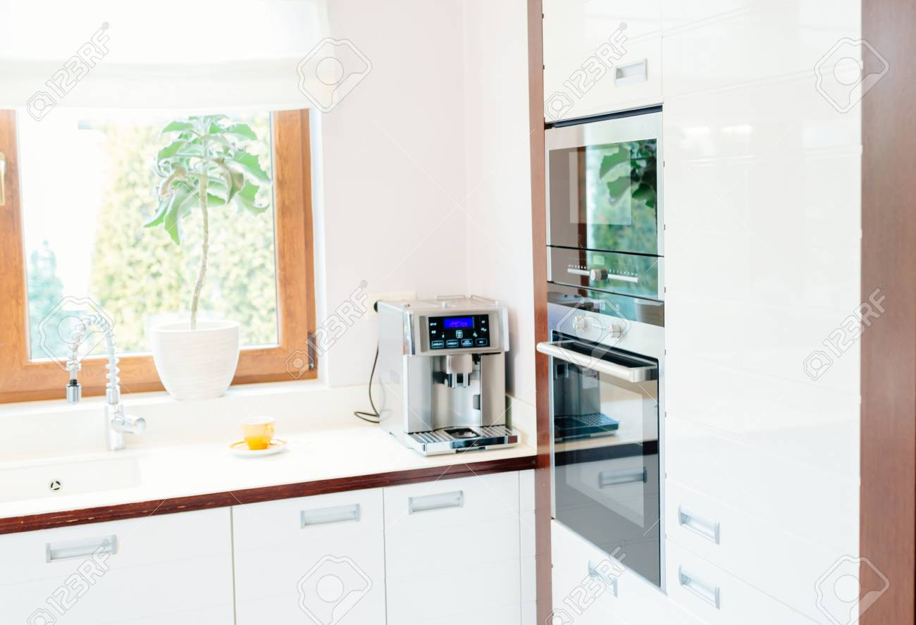 Modern House Kitchen With White Wooden Furnitures And Window Stock Photo    96803623