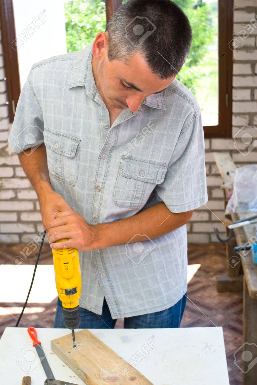 Professional man with drill. Stock Photo - 5128726