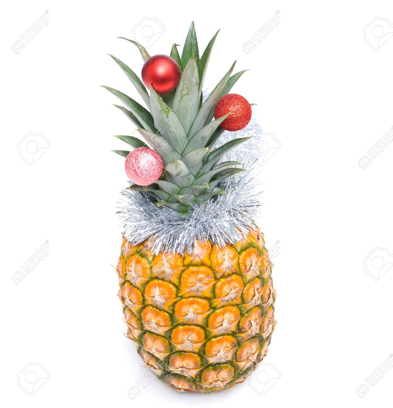 Christmas Pineapple.Fresh Pineapple Decorated Christmas Toys On A White Background
