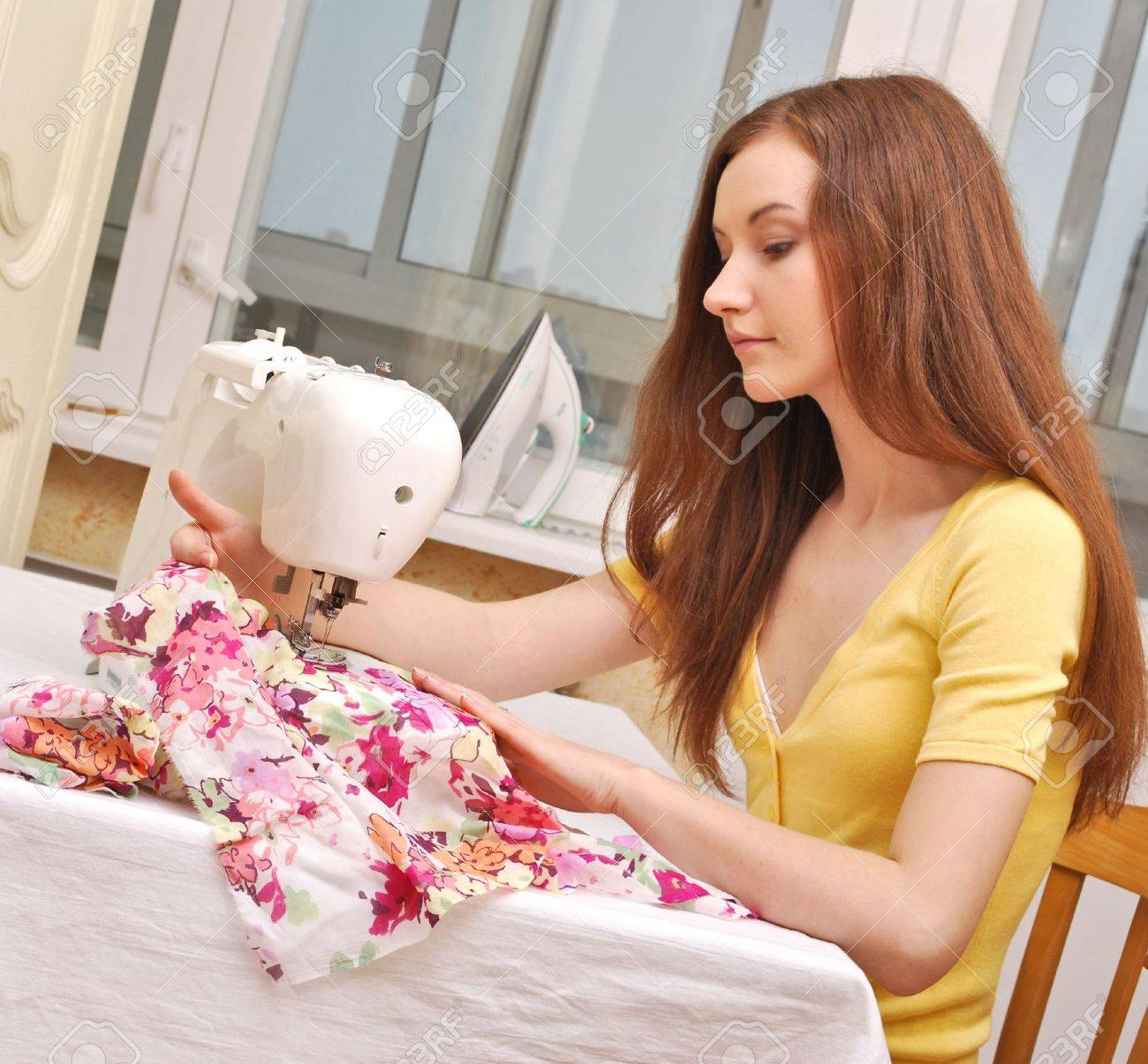 Woman seamstress work on the sewing-machine Stock Photo - 9367119