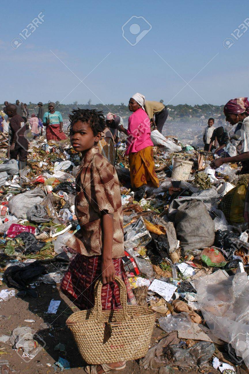 Maputo, Mozambique - May 14, 2004: a poor child in the landfill capital of Maputo in Mozambique. There are many street children in the garbage looking for food, bottles, Latin iron to resell                                Stock Photo - 8944701