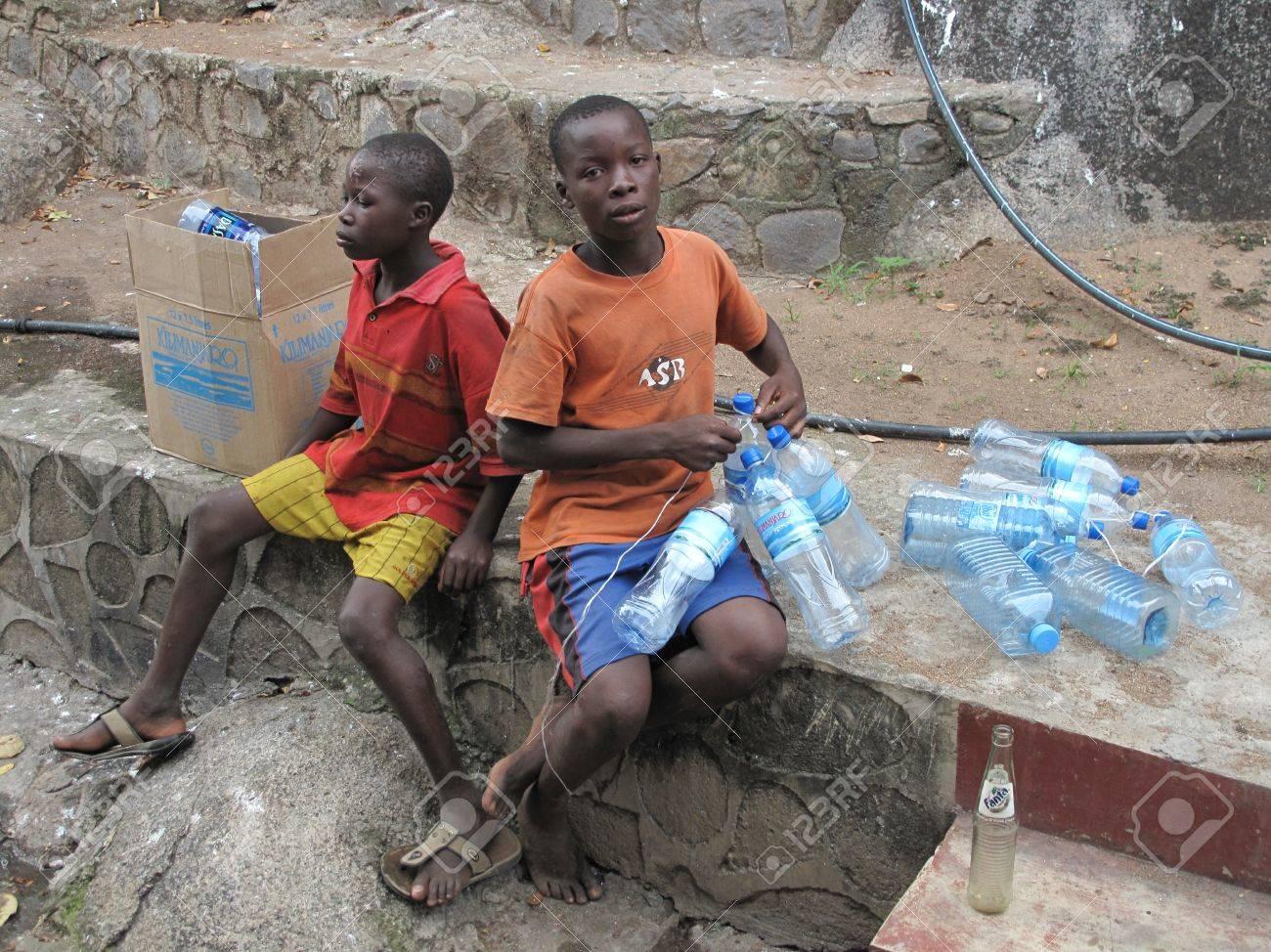 Mwanza,Tanzania,March,14,2010 : unidentified street children collects plastic bottles to sell them in Mwanza Tanzania March 14, 2010 Stock Photo - 12618638