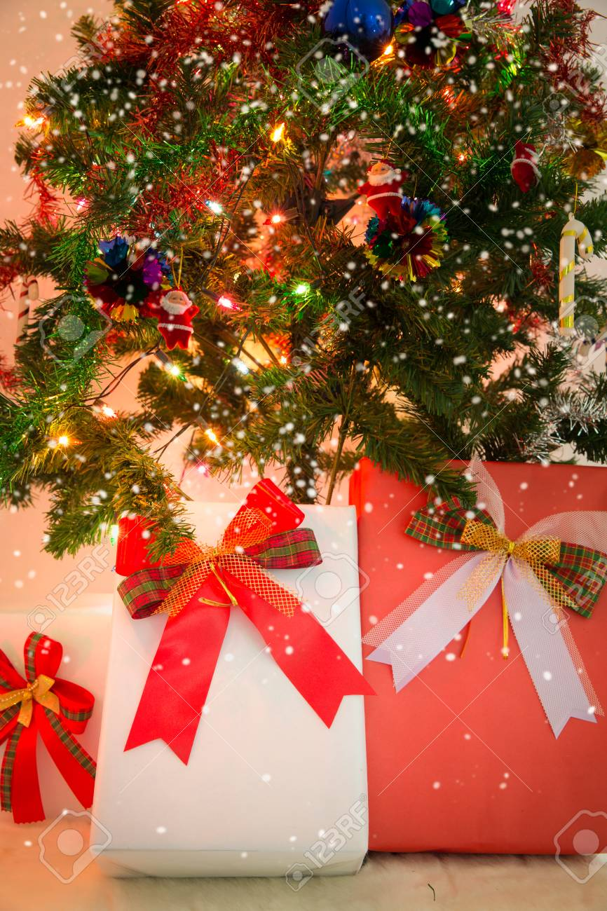 christmas gift box and decorated christmas tree in warm tone photo stock photo 68867262