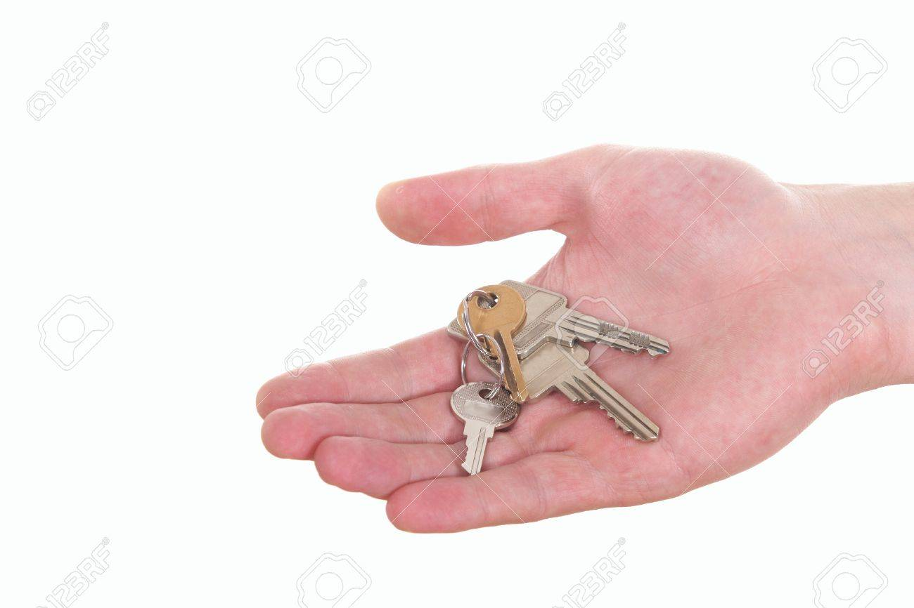 A hand is giving someone a bunch of keys. Isolated over white. Stock Photo - 4213777
