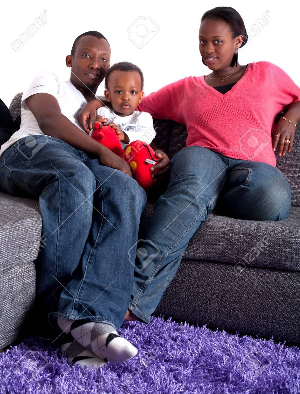 Young afro american family in a living room setting. Stock Photo - 7410146