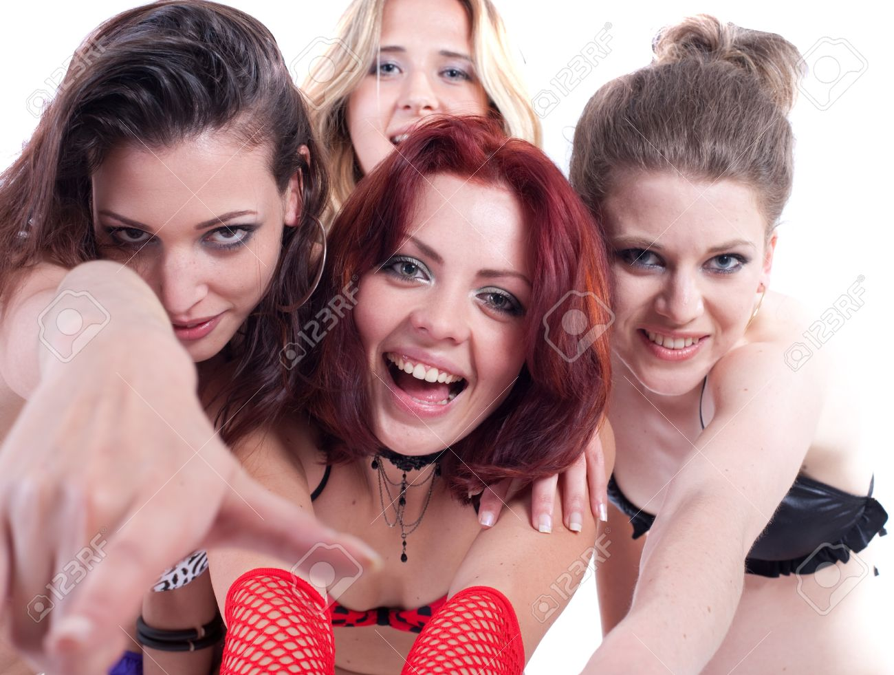 Stock Photo - Young group of four models with bikini. They are all partying  and having fun.