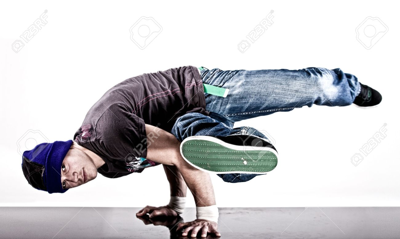 dcd891598445a Stock Photo - Young handsome fresh man breakdancing with stylish clothes.