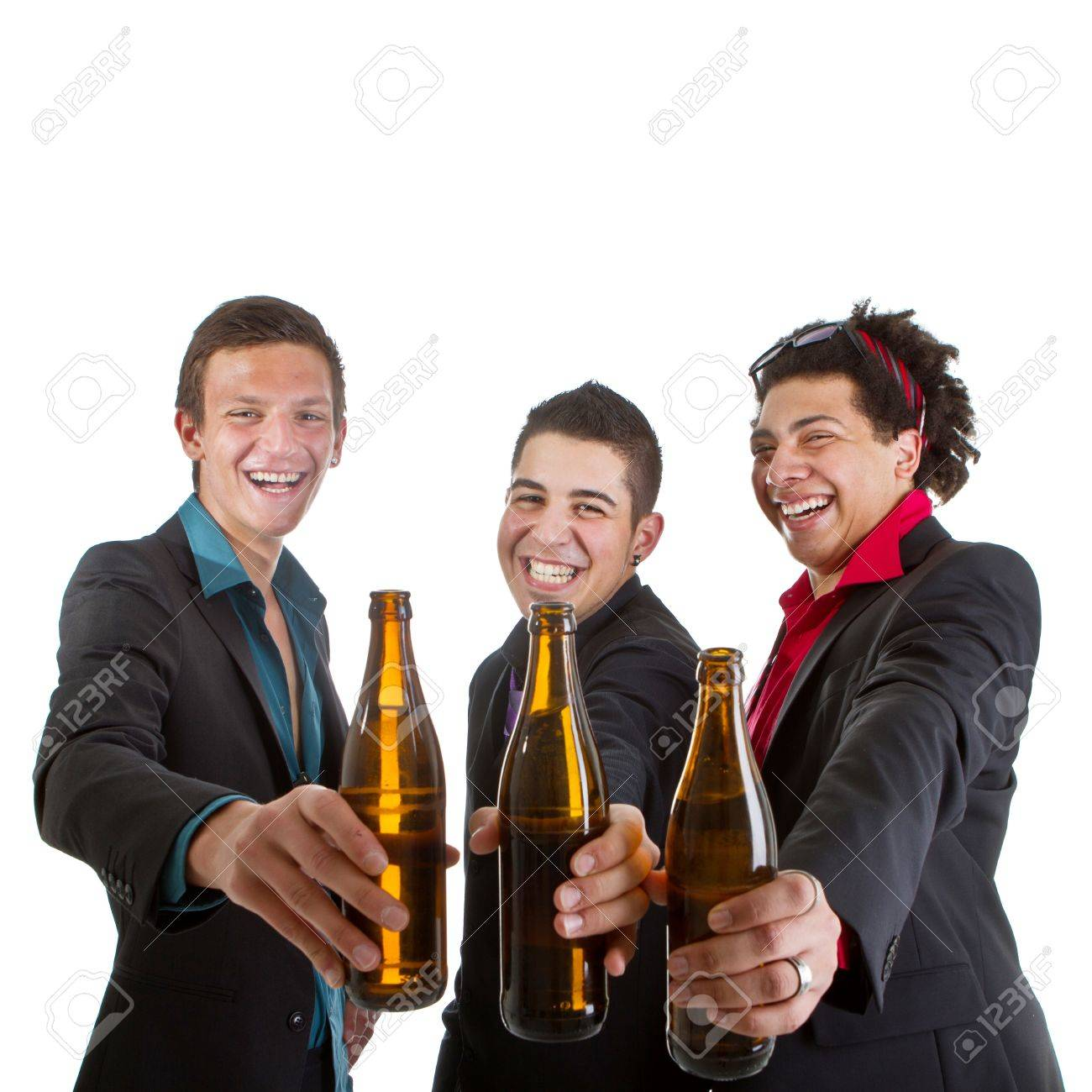 Three young men with business outfit with beer isolated over white. Stock Photo - 10159816