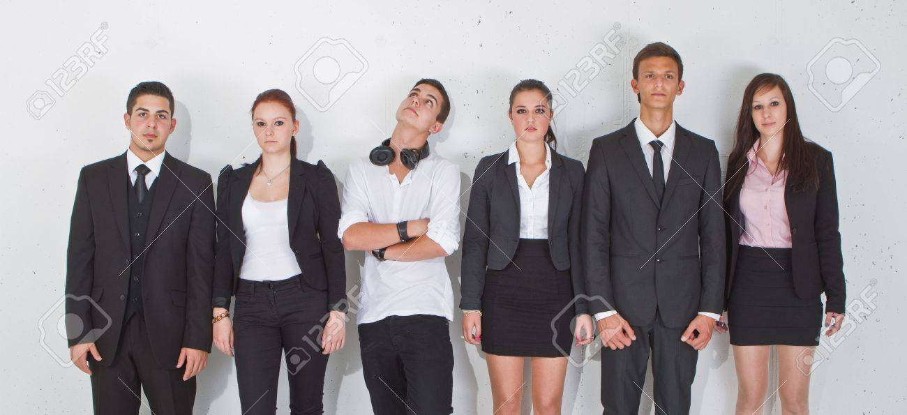 Young Group Of Teenage Business People With One Young Man Standing ...