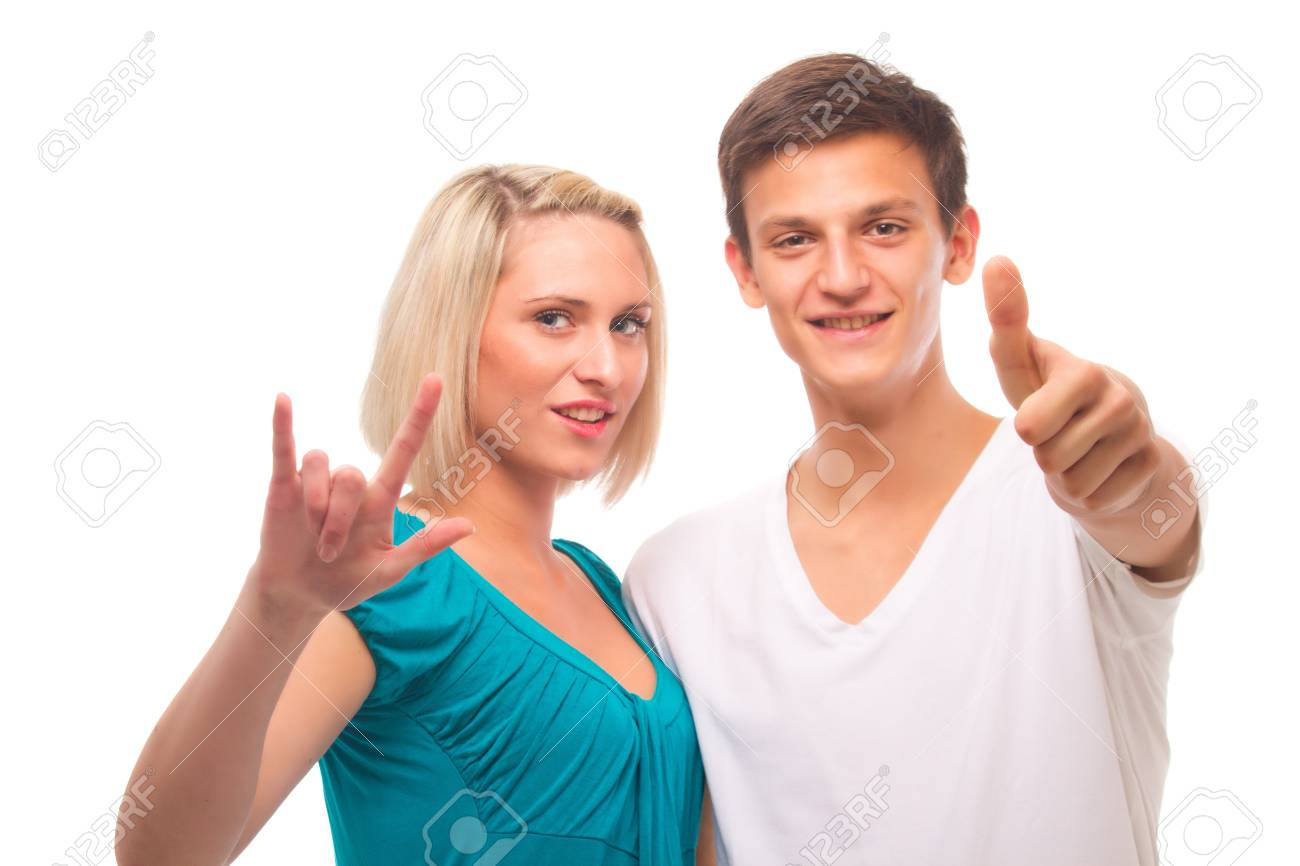 Young couple isolated over white showing thumbs up sign. Stock Photo - 11753976