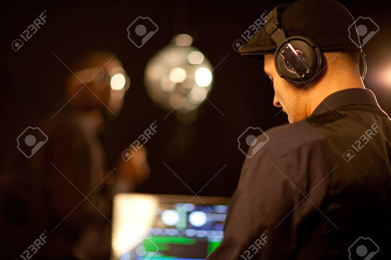 A young phillipino dj working in a club. Stock Photo - 12116429