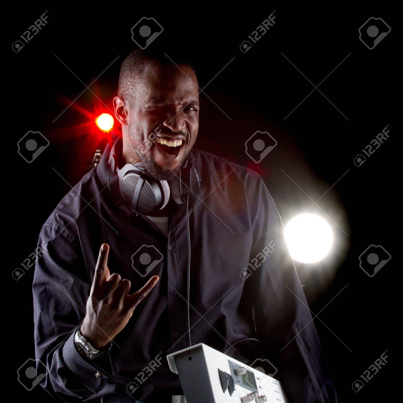 Young black man with a keyboard and headphones over black background Stock Photo - 12654555