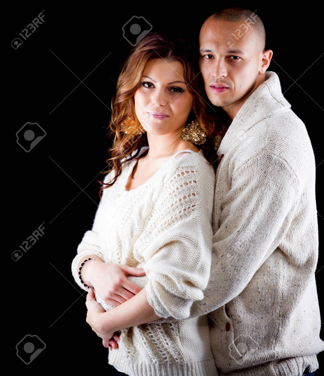 Young interracial cute looking couple over black background Stock Photo - 12654596
