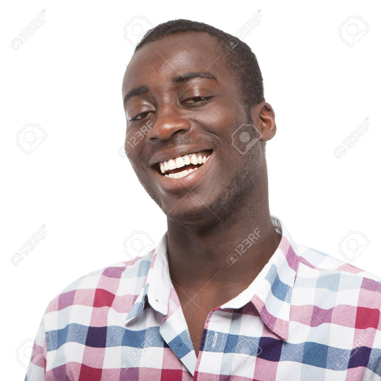 Young black man with a nice smile over white background. Stock Photo - 13932925
