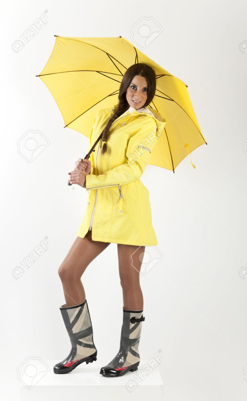 Yellow Raincoat And Rubber Boots Stock