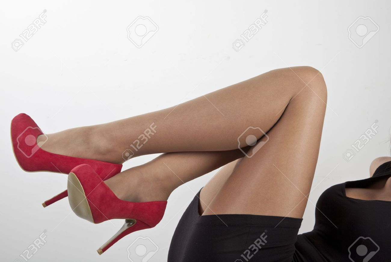 Stock Photo - women legs in red shoes and black dress on white background 1d710aec90