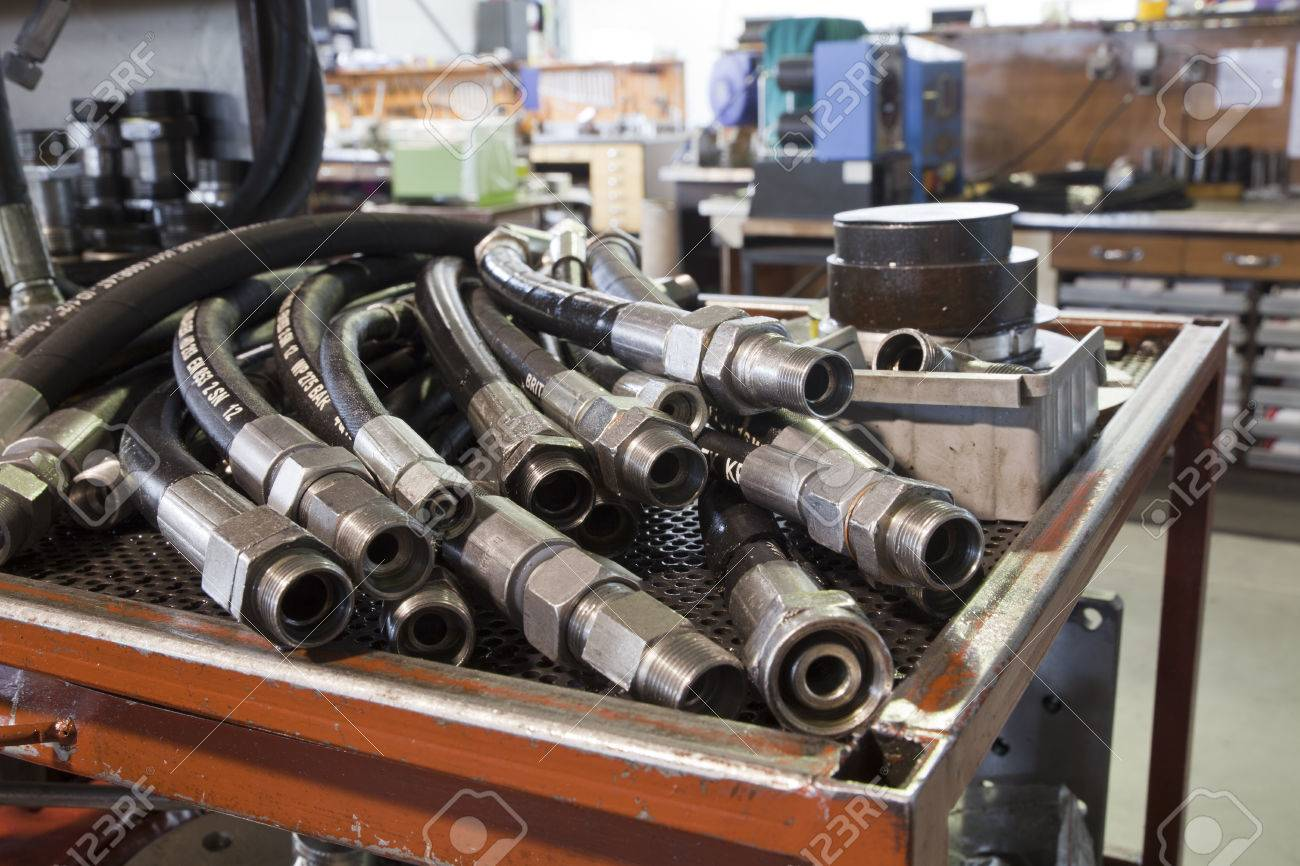 hydraulic hoses on the table in the workshop - 39436430