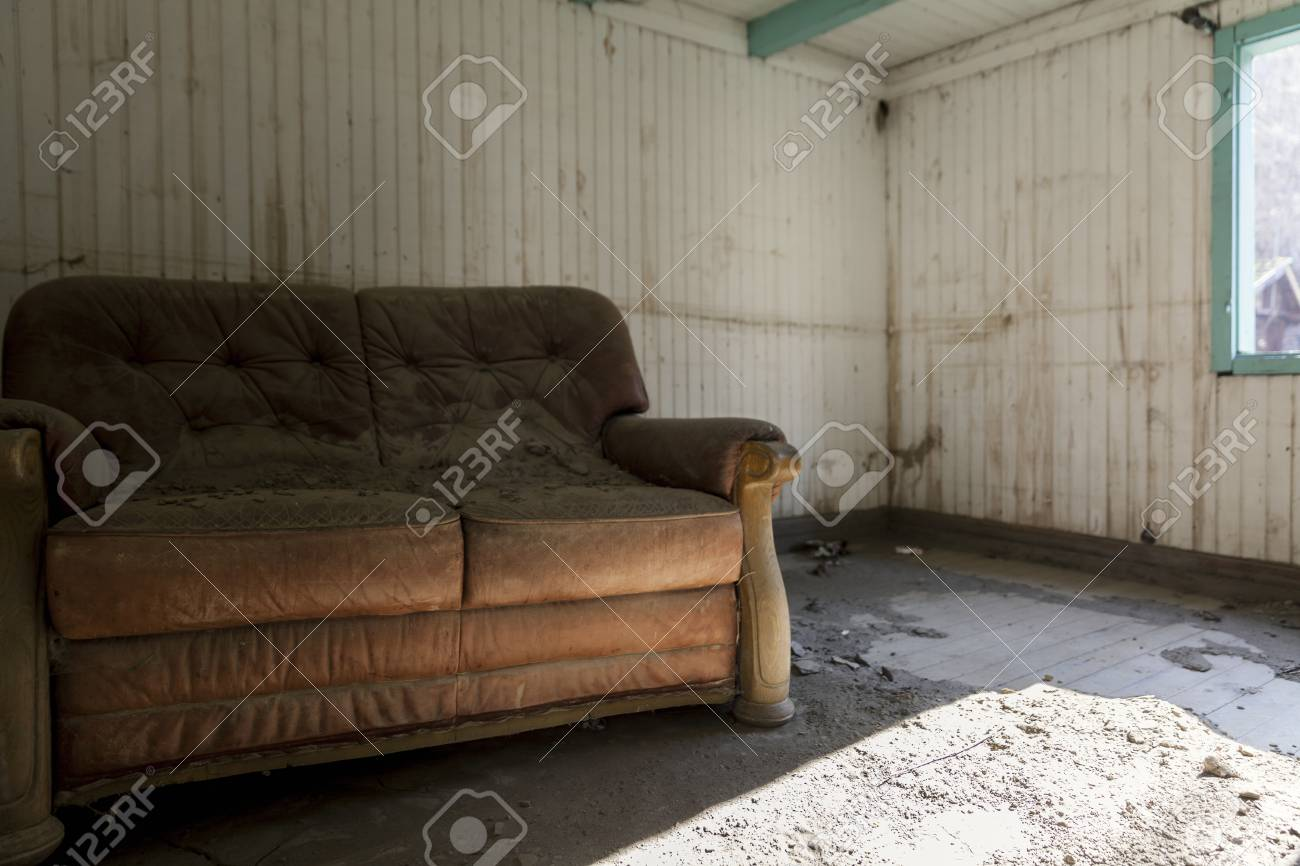 old leather sofa in an abandoned house