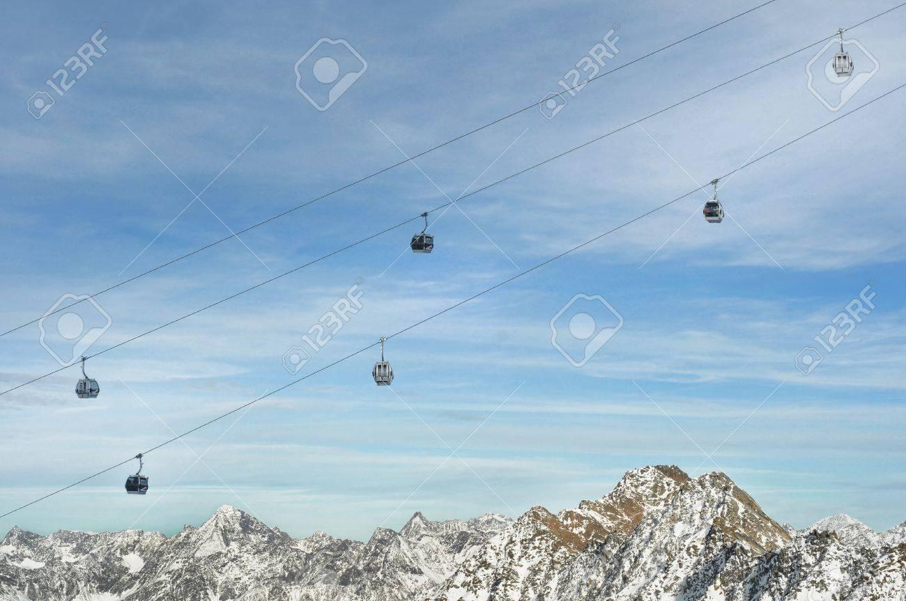 Winter Holiday Gondola Ski Lift Above Alps Mountains Stock Photo - 8651758