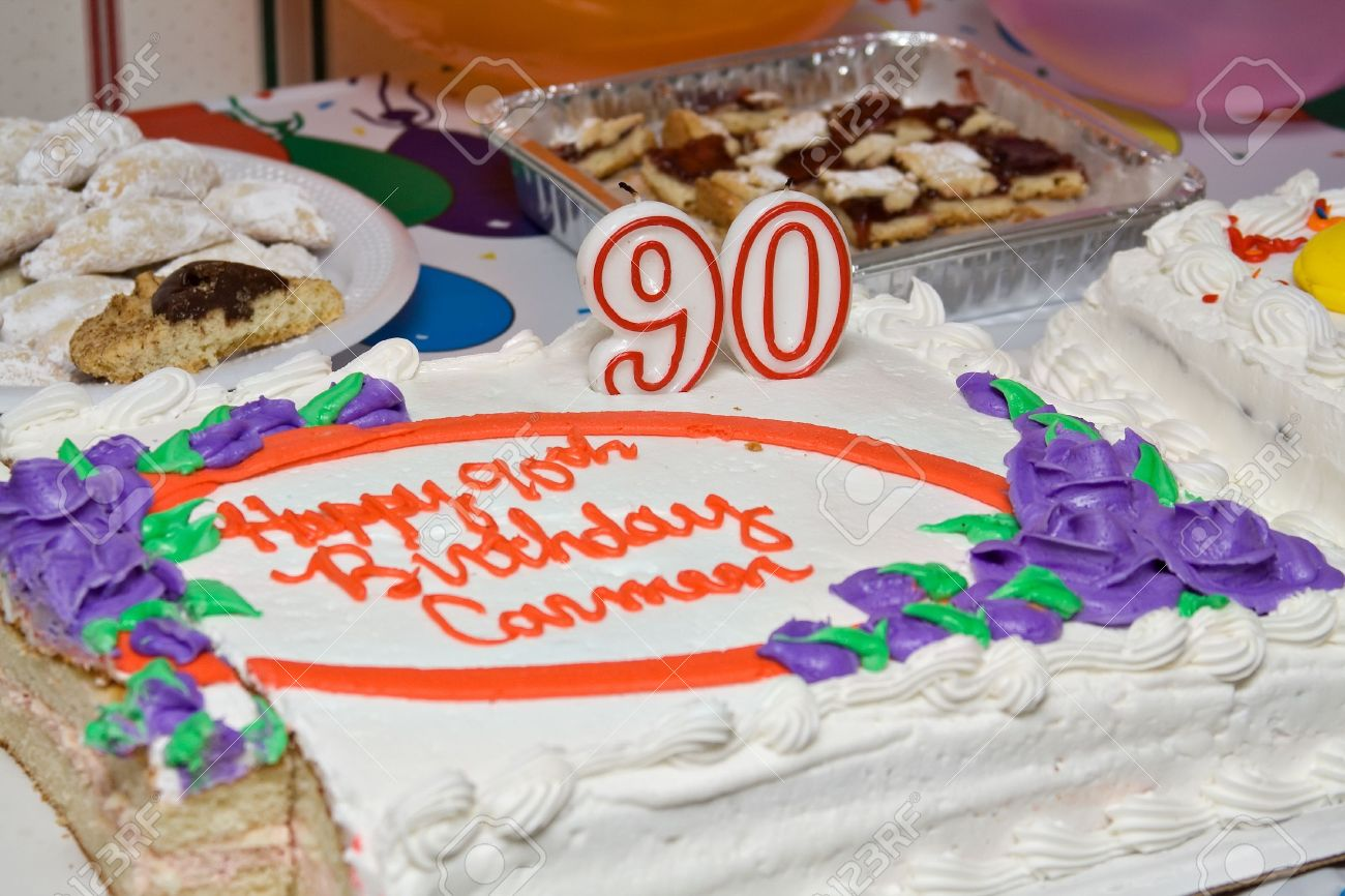 A Birthday Cake And Other Sweets To Celebrate 90th Stock Photo
