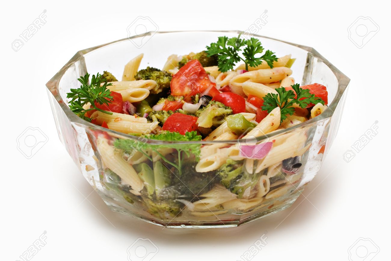 A Clear Glass Bowl Of Fresh Garden Pasta Salad On White Background