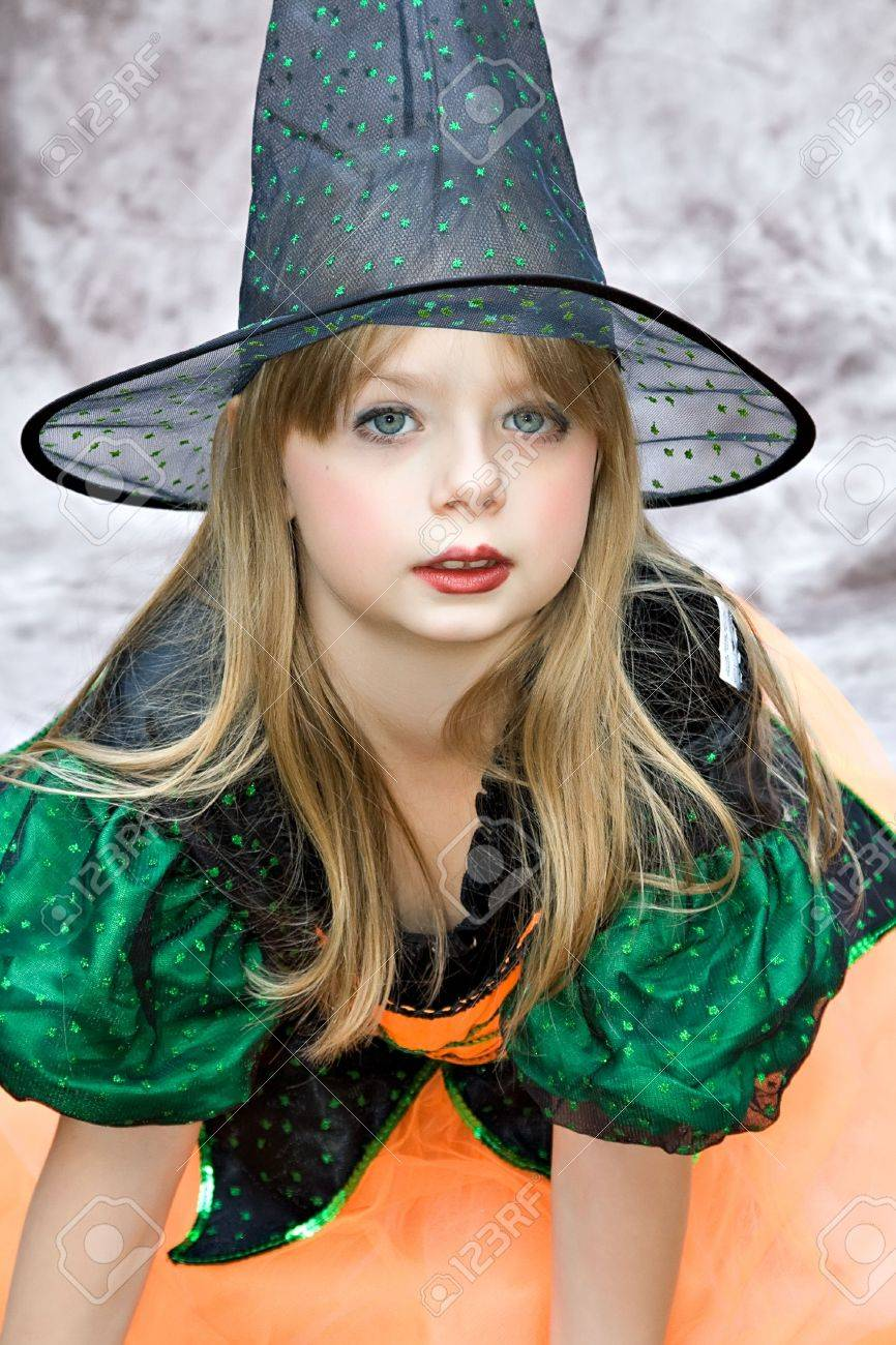 Small Girl In A Witch Halloween Costume Complete With Lipstick ...