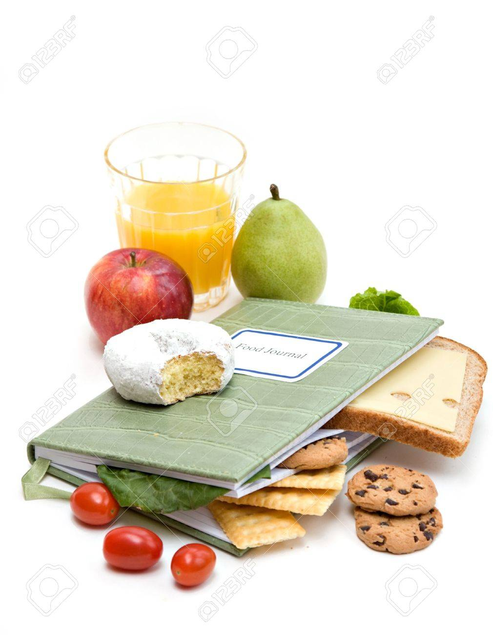 food journal or diary surrounded with different foods health