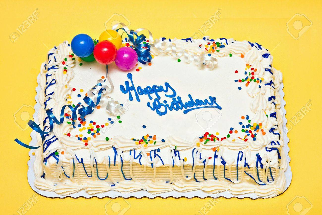 Decorating With Sprinkles Large Decorated Birthday Cake With White Icing Sprinkles Ribbons