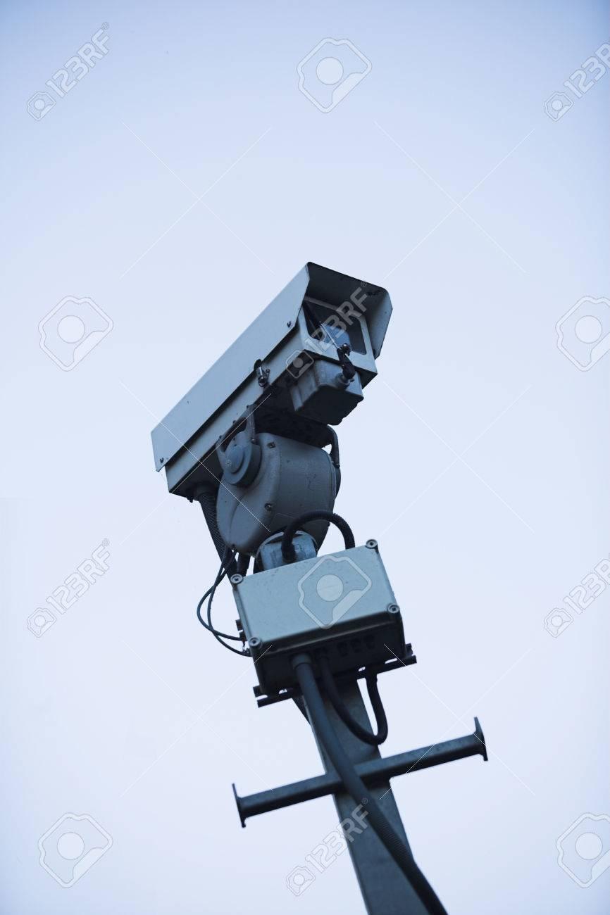 CCTV camera mounted on a pole - deliberately stark image Stock Photo - 1576462