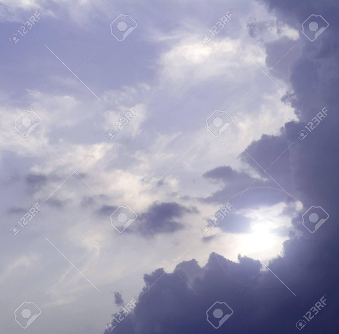 sunrays striking through a cloudy sky Stock Photo - 5114510