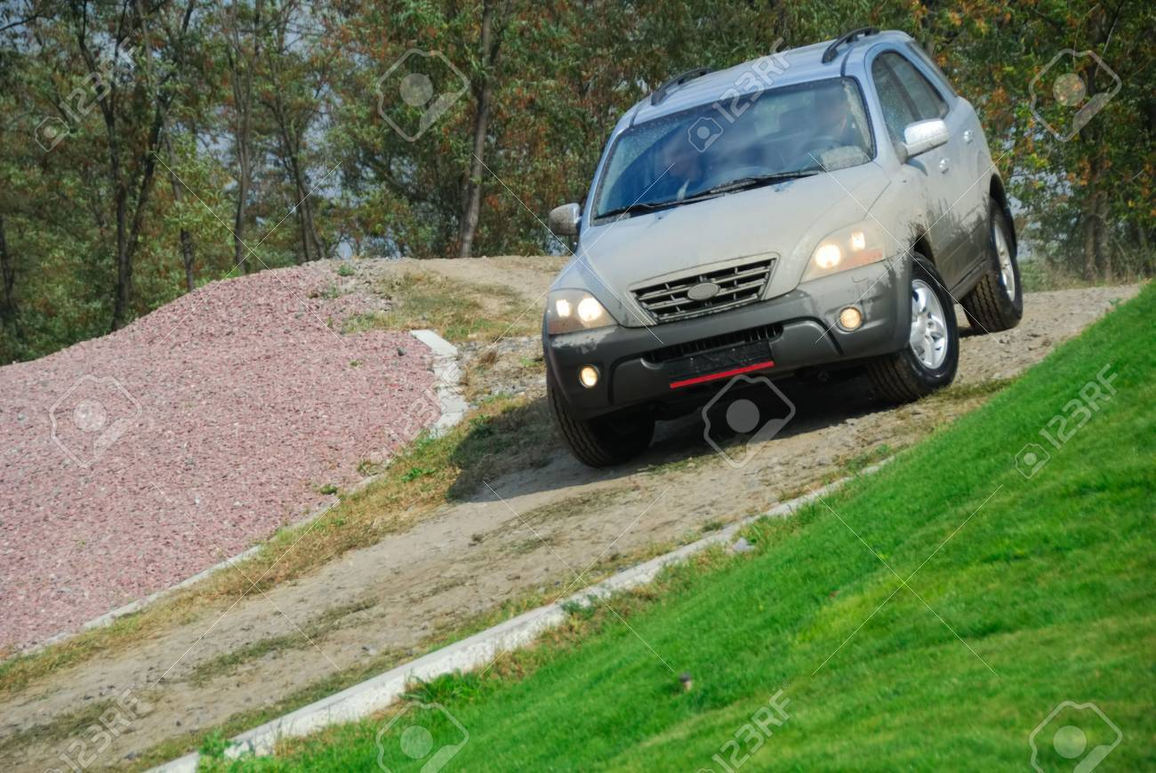 Offroad car moving on the hill Stock Photo - 2163284