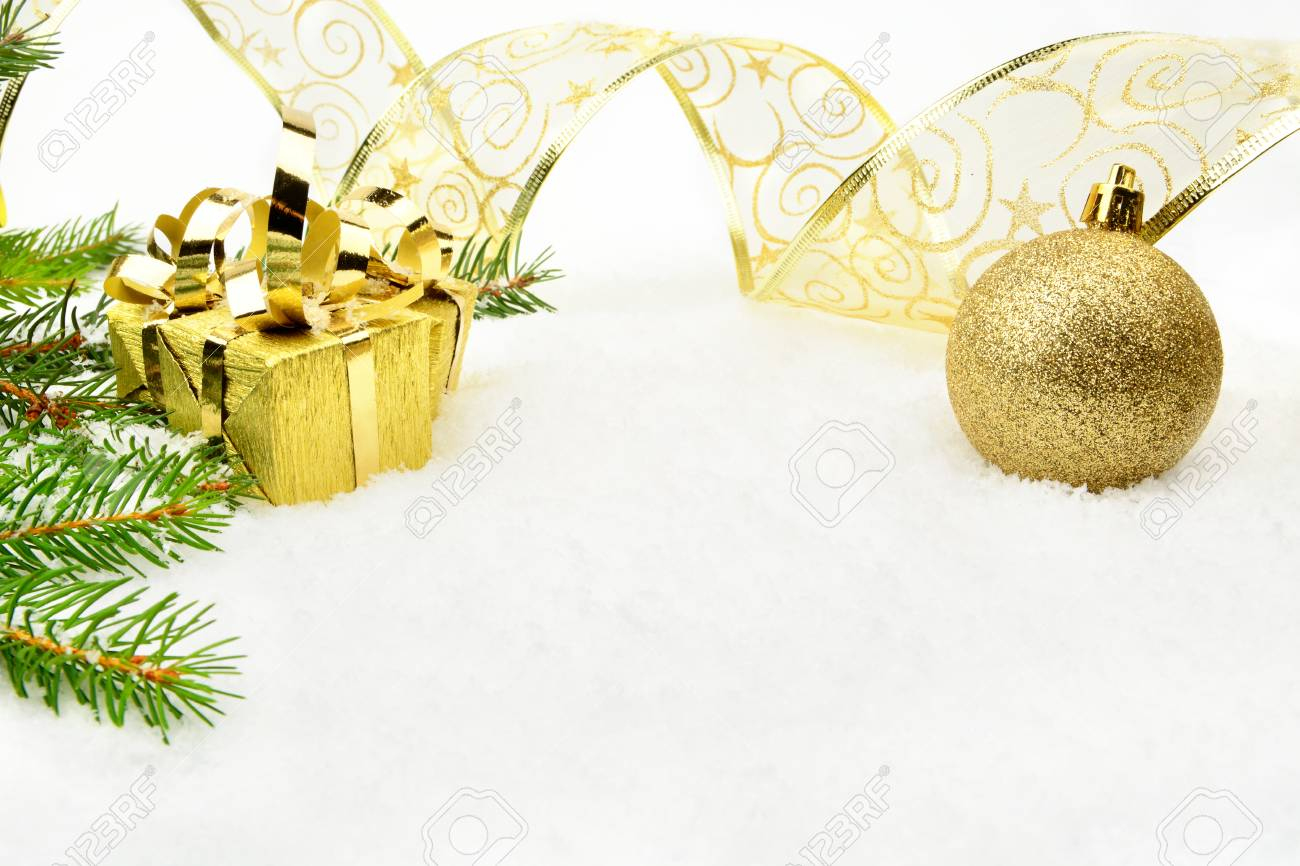 Decoration Of Golden Christmas On Snow With Christmas Tree Branch