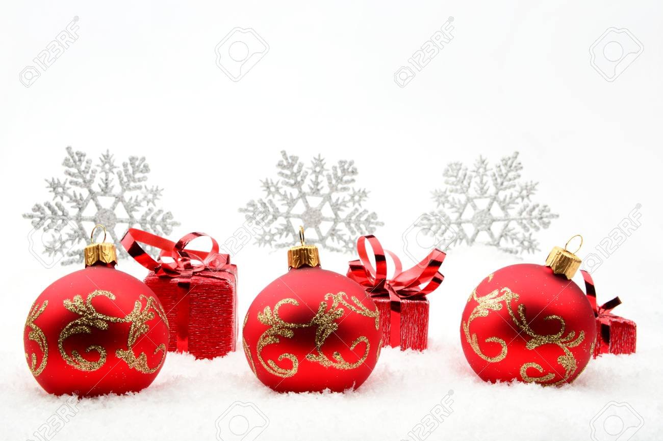 3f79f35d14f92 Decoration of red christmas gifts and baubles and snowflakes on snow on white  background Stock Photo