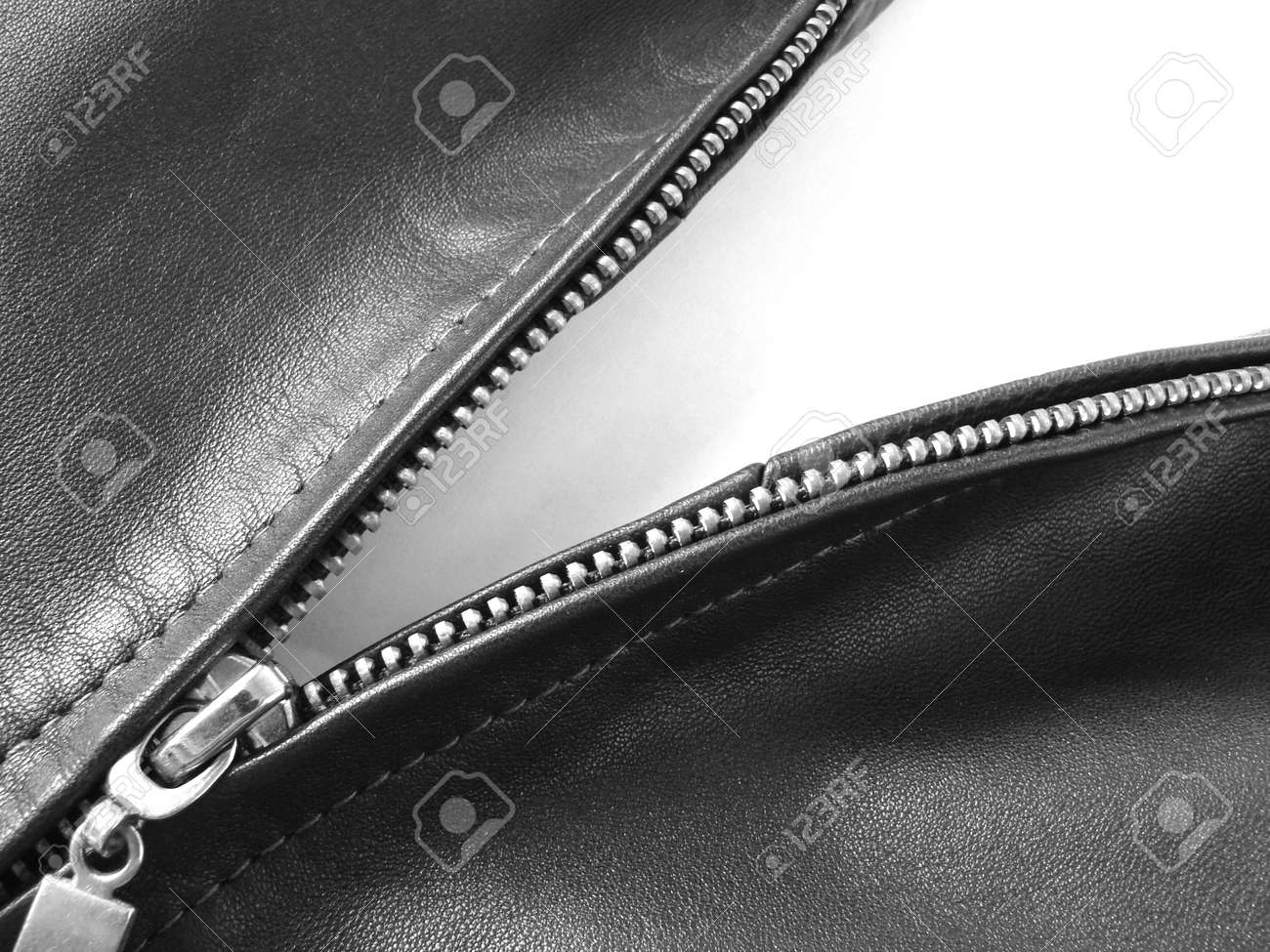 black and white fragment of a metallic zipper in a leather jacket - 717790